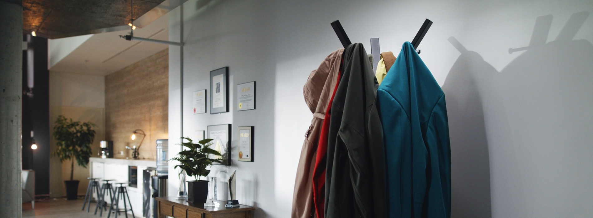 Full coat rack in an office space