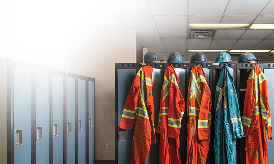 Teal CWB Coveralls amongst orange ones
